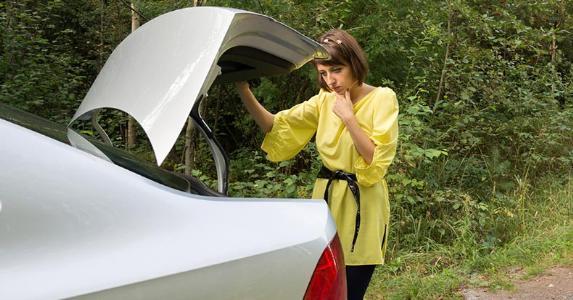 Woman checking car's trunk   iStock.com/K-Paul