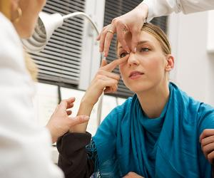 Woman consulting plastic surgeon for rhinoplasty
