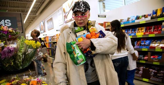 Woman holding groceries in her arms   Gina Ferazzi/Getty Images
