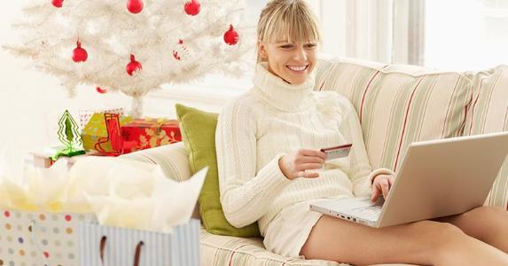 Woman doing holiday shopping from living room | Gazimal/Getty Images