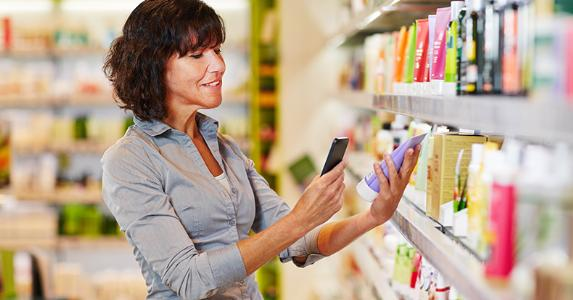 Woman scanning barcode of cosmetic product with smartphone © Robert Kneschke/Shutterstock.com