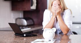Woman upset about finances © michealjung/Shutterstock.com