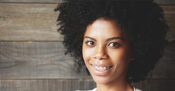 Woman wearing braces | WAYHOME studio/Shutterstock.com