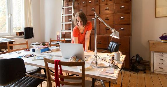 Woman working in home office | Simon Ritzmann/Getty Images