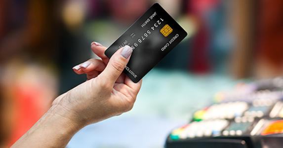 Woman's hand holding credit card in store © dean bertoncelj/Shutterstock.com