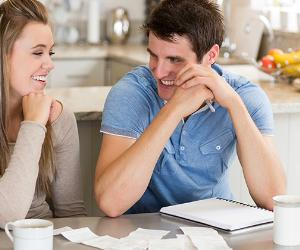 Young couple sorting budget in kitchen table © iStock