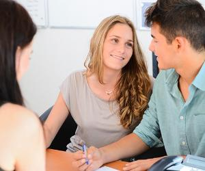 Young couple talking together in an office