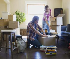 Young couple unpacking boxes from the move   Hero Images/Getty Images