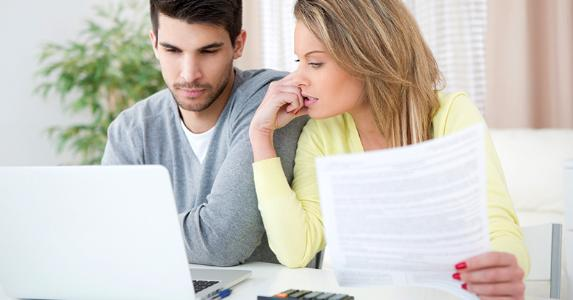 Young couple working on finances at home