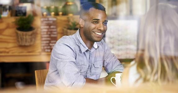 Young man in coffee shop | PeopleImages.com/DigitalVision/Getty Images