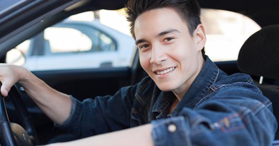 Young man driving car © Kiefer pix/Shutterstock.com