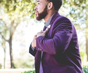 Young man wearing purple suit | William Stitt/Unsplash