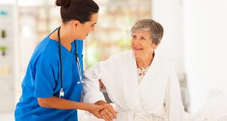 Nurse helping older woman © michaeljung/Shutterstock.com