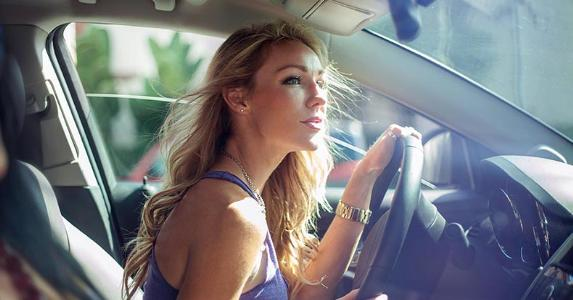 Young woman driving her car | Cultura RM Exclusive/Seb Oliver/Getty Images