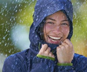 Young woman in blue rain jacket