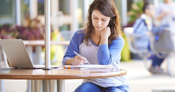Young woman studying outside © iStock