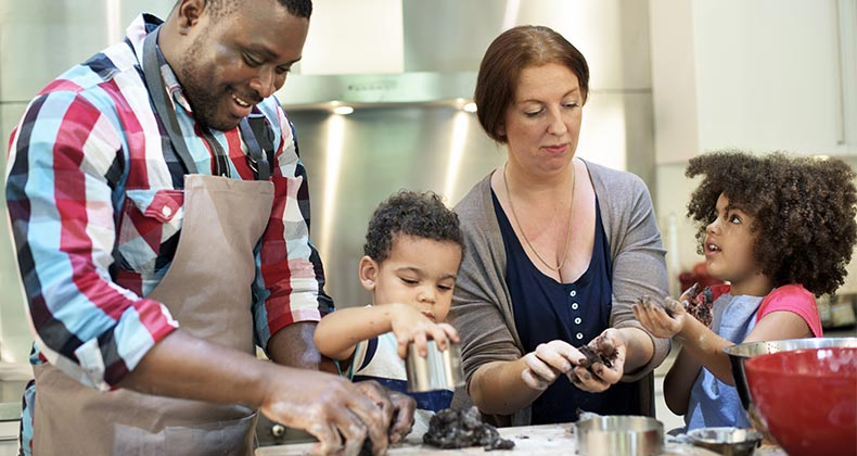 Parents cooking with their children |