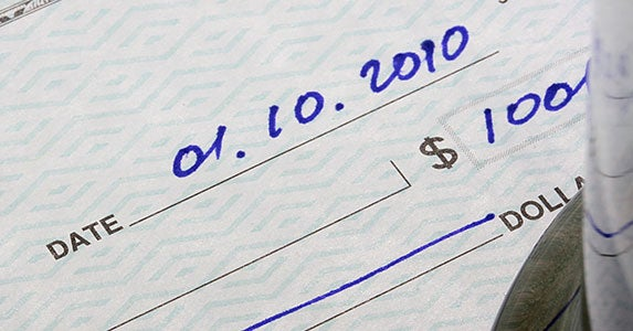 Successfully cashing old checks © Constantine Pankin/Shutterstock.com